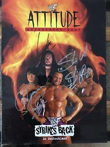 WWF Autographed Program Signed By Undertaker, Stone Cold Steve Austin & Chyna
