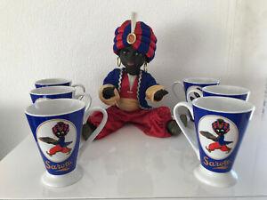 """Werbefigur """"Sarotti Mohr"""" Puppe mit Schlafaugen ca. 40cm mit 6 Porzellan Tassen."""