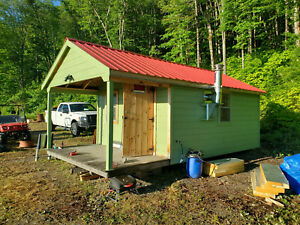 41.4 Acres on the US Canadian border in Maine with a tiny cabin and great view