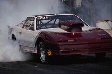 573042 un Pontiac Firebird crea un billowing nube de neumático Humo A4 Foto Impresión