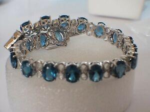 "25CT of London Blue Topaz 8x6mm gemstone Bracelet 7"" MSRP 1,000."