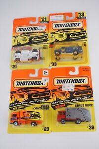 Lot of 4 Matchbox 1/64 Refuse #36 Utility #33 Volvo Truck #23 GMC Wrecker #21
