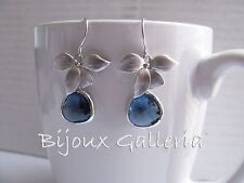 Silver Plated Orchid with Sapphire Blue Gemstone Teardrop Dangle Drop Earrings.