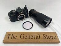 Minolta X-700 - Tokina AT-X 35-200mm 1:3.5-4.5 67mm Lense - Hoya 1B Filter