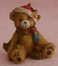 CHRISTMAS BEAR SITTING WEARING SANTA HAT AND MULTI COLOURED SCARF