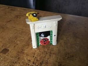 TAYLOR&BARRETT FIREPLACE AND YELLOW PHONE CIRCA1930s.DOLLS HOUSE ACCESSORIES