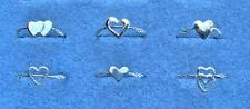 HALF-DOZEN STERLING SILVER RINGS with HEART MOTIFS.  (1714-SS)
