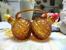 AMBER GLASS OIL & VINEGAR CRUET SET.