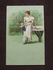 PRETTY LADY IN WHITE SITTING ON A TABLE IN THE GARDEN Vtg POSTCARD