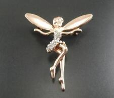 Rosy gold tone fairy brooch / pin with crystal