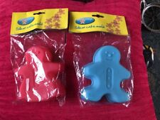 Set Of Two Silicone Gingerbread Man Cake Moulds In Red And Blue Dunelm