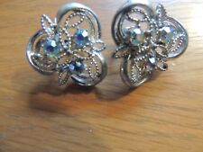 Vintage Signed CORO earrings with aqua rhinestones, silver tone clip ons.