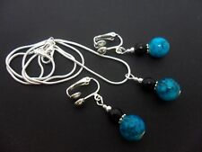 A SILVER PLATED TURQUOISE/BLACK PEARL  NECKLACE AND CLIP ON EARRING SET. NEW.