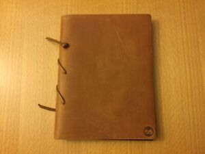 "Leather bound note book (9"" x 7"")"