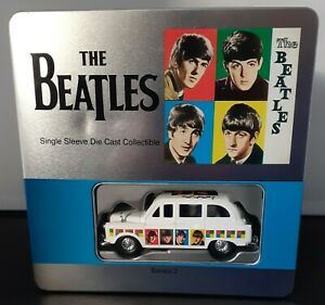 The Beatles Single Sleeve T Shirt and Die Cast Car Collectors Set.
