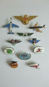 Eleven airline and airport related pin badges