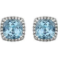 Genuine Sky Blue Topaz & .06 ctw Diamonds Halo Studs Earrings in 14K. White Gold