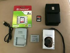 Canon PowerShot Digital ELPH SD1300 IS 12.1 MP Digital Camera - Silver plus more