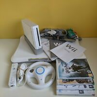 Premium Wii Bundle: Boxed Wii, Wii Fit board, official accessories & games.