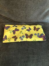 Handmade soothing yoga eye pillow in yellow cotton fabric with butterflies