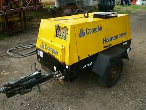 Compair Holman 2150s air compressor. Low hours. With hoses. Tidy.