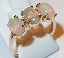 Ethiopian Welo Opal 3-stone/Trilogy Ring (1.50ct) in 9k Yellow Gold. Size M.