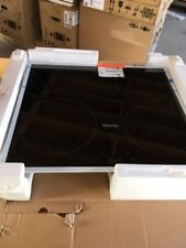 Miele KM 6115 Electric Induction Hob - Black with stainless steel frame.