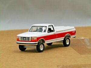 dcp/greenlight Custom lifted 1992 white/red Ford F150 pick up truck 1/64.