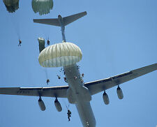 Paratroopers from the 82nd Airborne Jump from a C-141-McGuire AFB