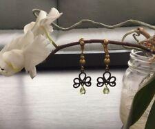 "Dainty 2.25"" dangle clip on earrings - brass-colored swirls with green stone"