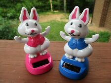 """Set of 2 New Solar Dancing 4"""" Tall Bunny Rabbits- One Pink Dressed, One Blue"""
