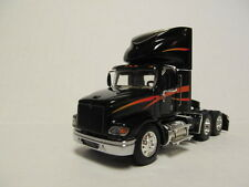 DCP 1/64 SCALE  INTERNATIONAL  DAY CAB  BLACK WITH ORANGE STRIPES (TRACTOR ONLY)