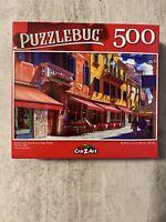 "Quaint Cafe Sunny Side Street | 500 Piece Puzzlebug Jigsaw Puzzle | 18.25"" x 11"""