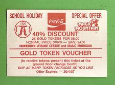 #D404.  1987  COCA COLA COKE GOLD TOKEN VOUCHER, MAGIC MOUNTAIN