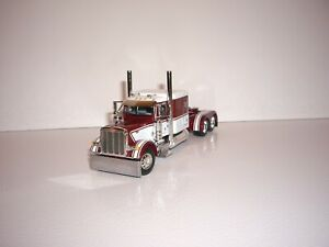 DCP FIRST GEAR 1/64 MAROON AND WHITE PETERBILT 379 WITH 63'' SLEEPER