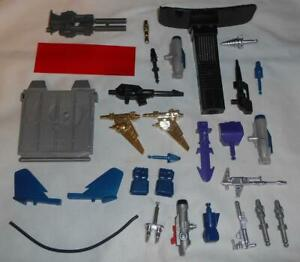 Assortment of G1 Transformers Accessories and Parts