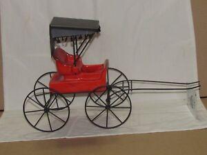 Black and Reddish Orange Carriage