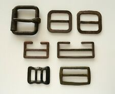 Dug out mixed lot: belt buckle, horse harness strap elements, decorative brass