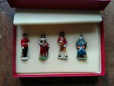 Four vintage character metal figures