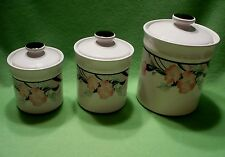 Set of (3) vintage Coffee Sugar & Tea canisters w/vibrant flowers & other design