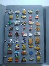 classeur de 135 pin's  avec attaches thème divers