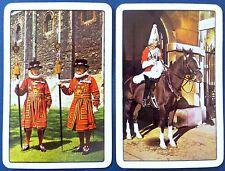 PAIR VINTAGE SWAP CARDS. ROYAL PALACE YEOMAN GUARDS & MOUNTED SENTRY.WADDINGTONS