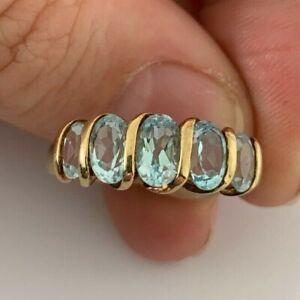 9ct gold five stone blue topaz ring, 9k 375