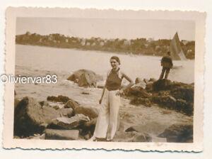 Vintage photo 1937 - pretty woman standing on seaside in polka dot shirt