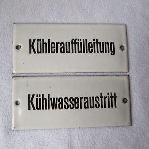 2 alte Emailschilder Kühlwasseraustritt Kühlerauffülleitung 15x6,5 Email-Schild