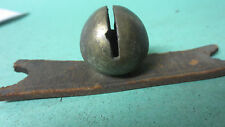 One brass apricot sleigh jingle bell on a piece of leather strap Q42