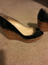 CHRISTIAN LOUBOUTIN UNE PLUME 100 BLACK PATENT CORK WEDGE 38
