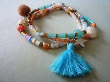 4strängiges modisches Stretch Armband Glas Perlen Bommel Stern Trend 7117