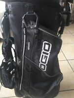 Ogio golf bag with used irons and driver