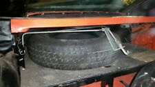 Opel Gt spare tire securing assembly